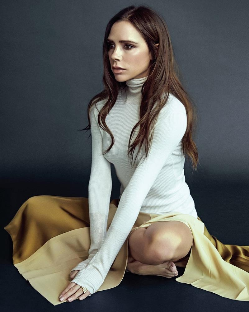 Victoria Beckham wears white rib-knit turtleneck with flouncy skirt