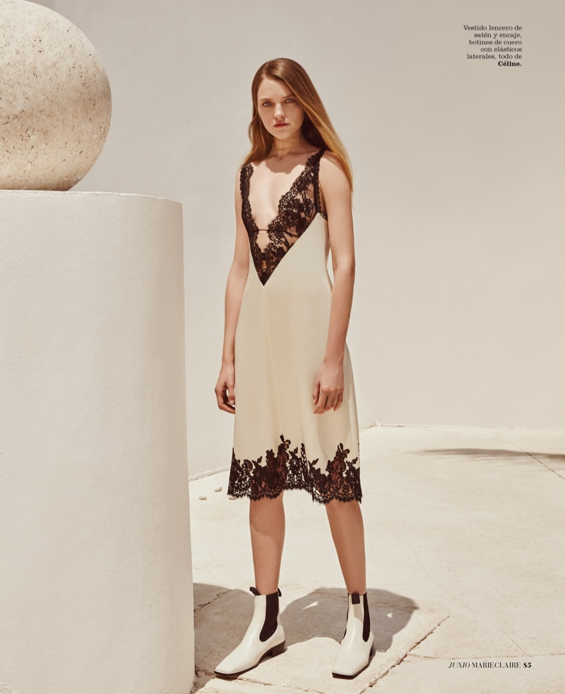 Vlada wears satin and lace dress by Celine