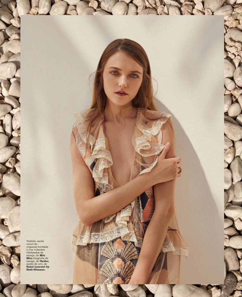 Vlada models lace and ruffle dress by Miu Miu