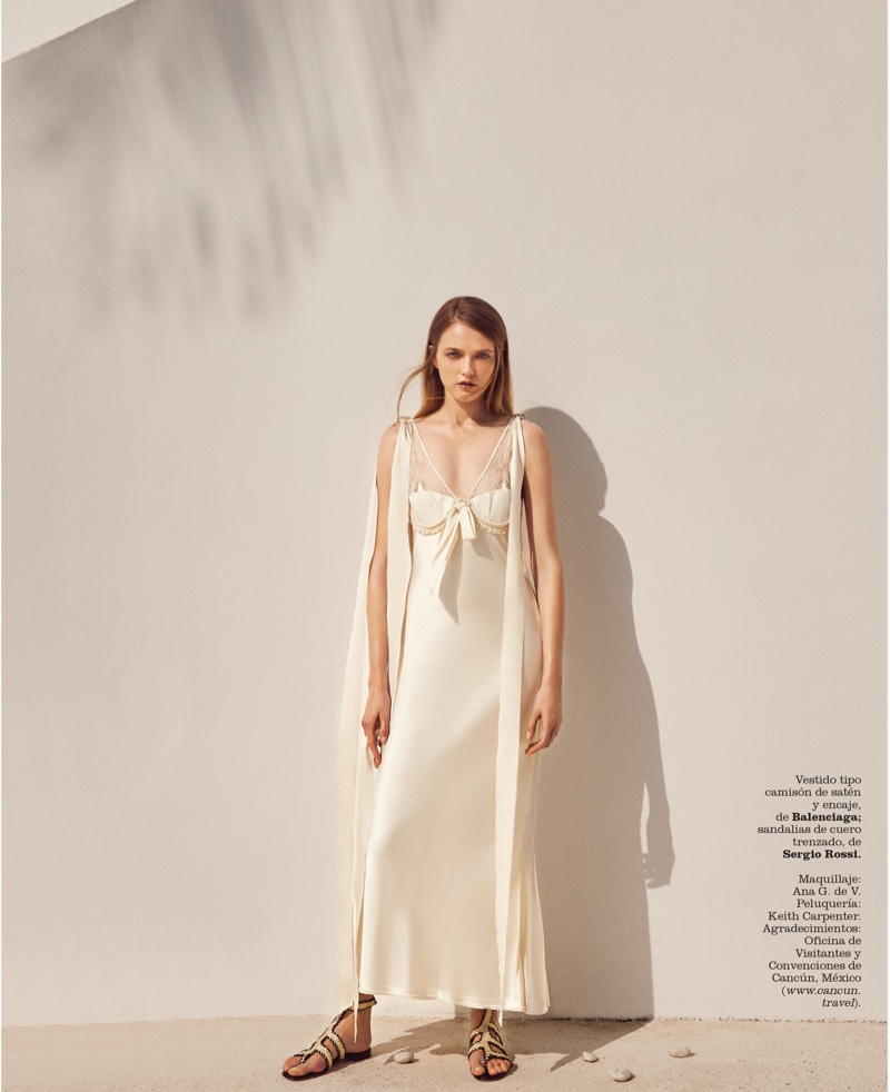 Vlada Roslyakkova wears Balenciaga satin slip dress with Sergio Rossi sandals