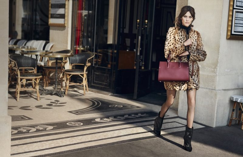 Alexa Chung takes Paris by storm in a reversible rabbit fur coat with Longchamp's red Paris Premier bag for the label's fall-winter 2016 campaign.