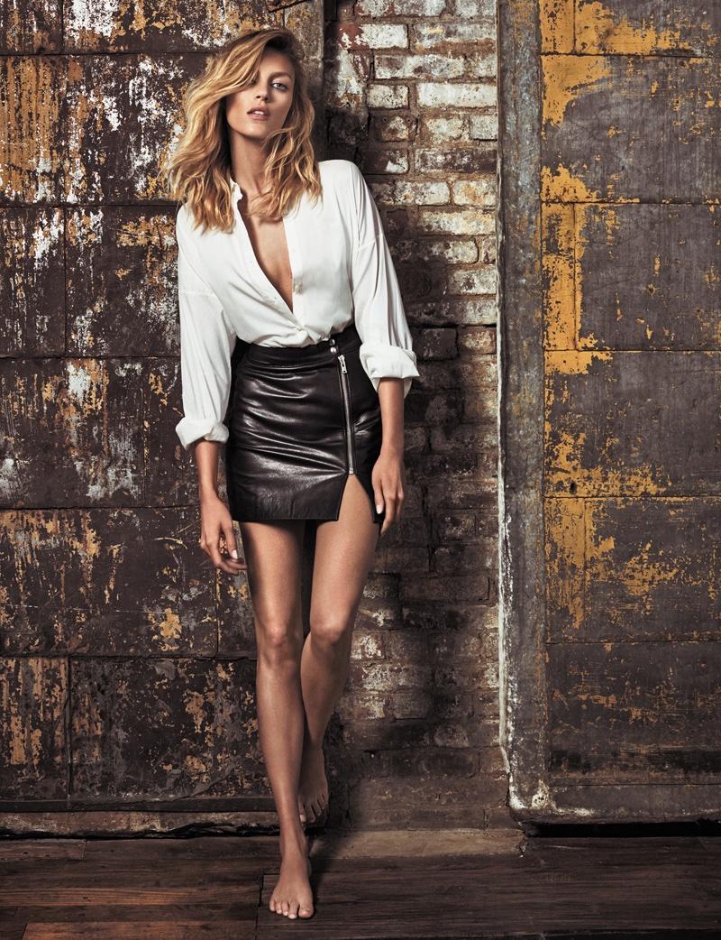 Anja Rubik flaunts some serious leg in an Anja Rubik x Iro top with leather mini skirt