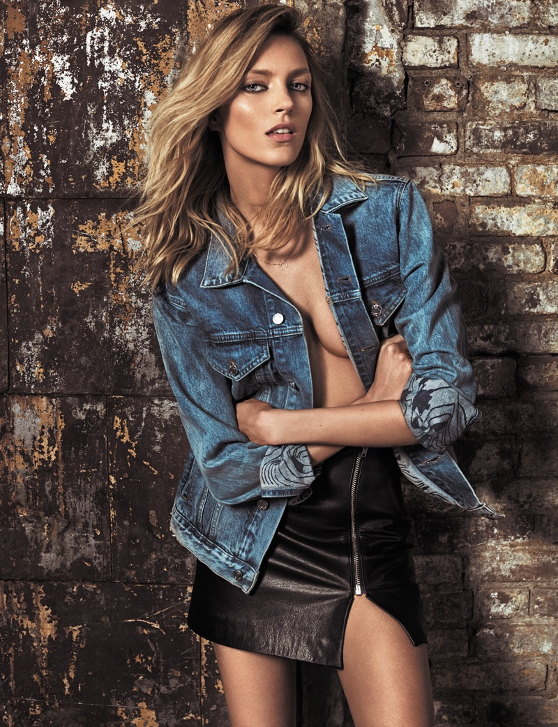 The blonde model wears denim jacket with leather skirt from Anja Rubik x Iro