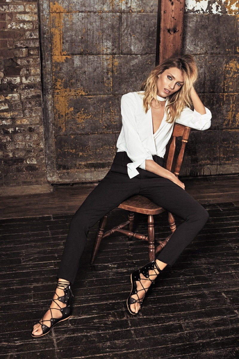 Anja Rubik wears white top and pants from Iro collaboration