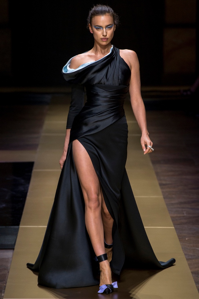 Atelier Versace Fall 2016: Irina Shayk wears black one-shoulder gown with high slit