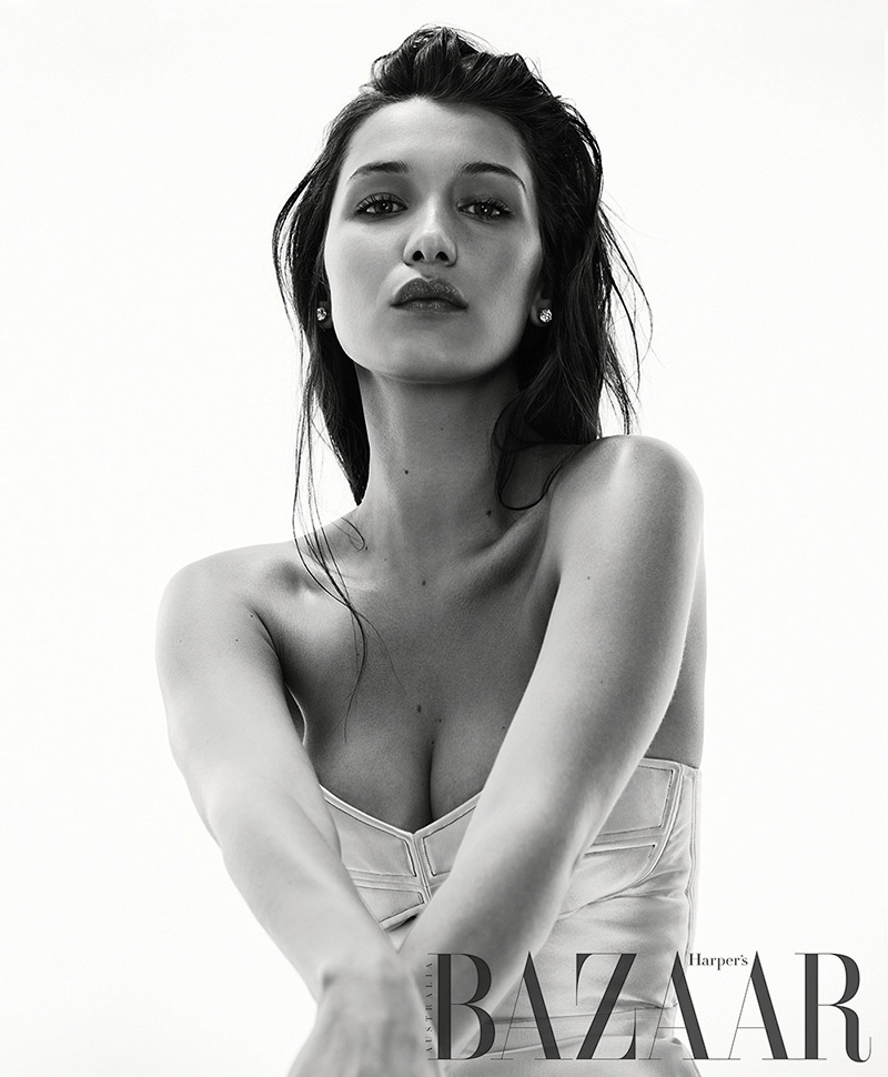 Photographed in black and white, Bella Hadid wears corset inspired top