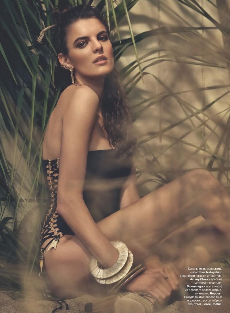 Carmen Ceclan soaks up the sun in strapless swimsuit look