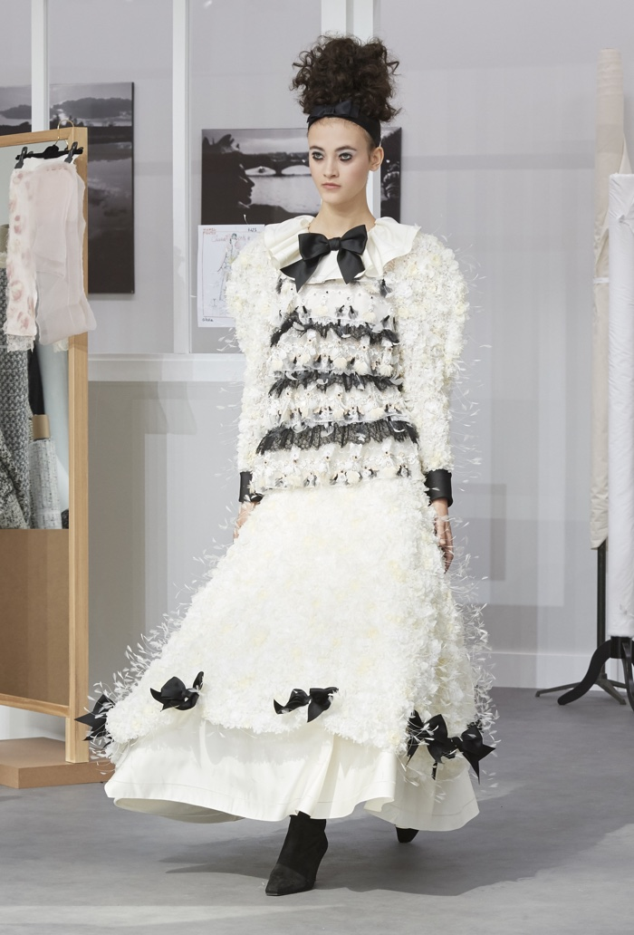 Chanel showcases ladylike fashions with an emphasis on sculpted shoulders.