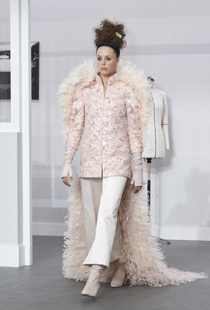 Chanel's haute couture fall-winter 2016 bridal look includes tailored trousers and a jacket with a train.