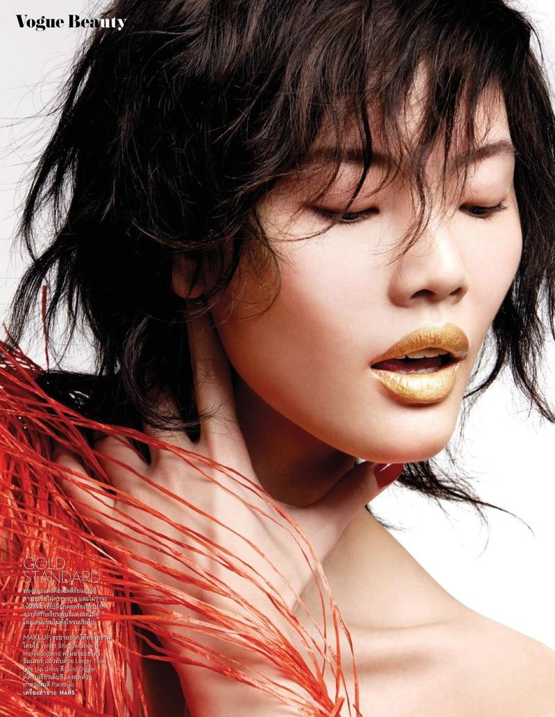 Chen Lin models gold lipstick in the editorial