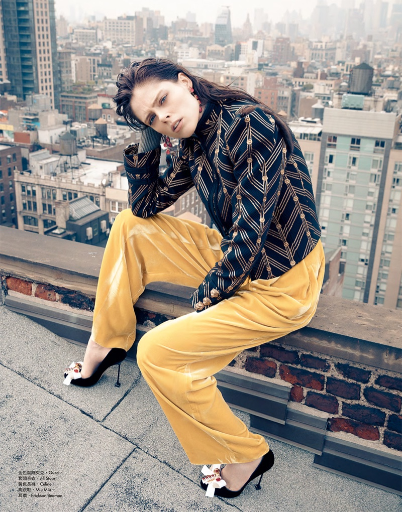 Coco Rocha models Gucci embroidered jacket with Celine pants and Miu Miu heels