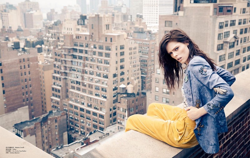 Coco Rocha poses on a New York City rooftop in the fashion editorial