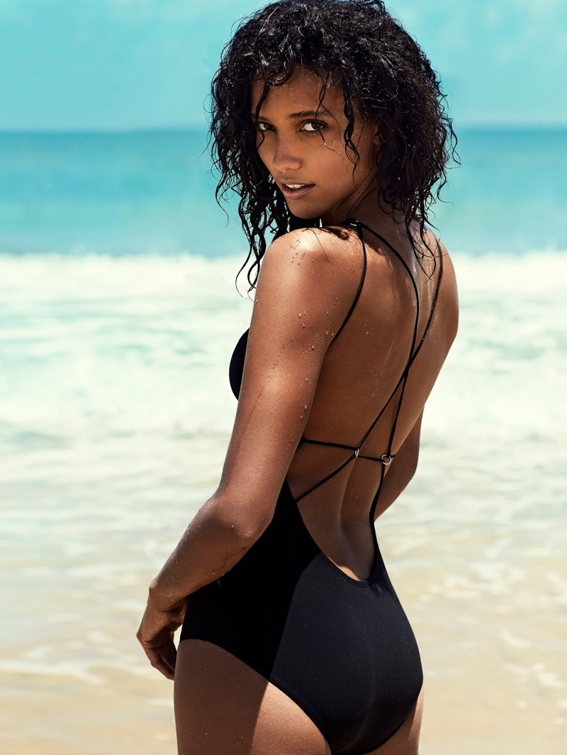 Cora Emmanuel wears Acne Studios one-piece with strappy back