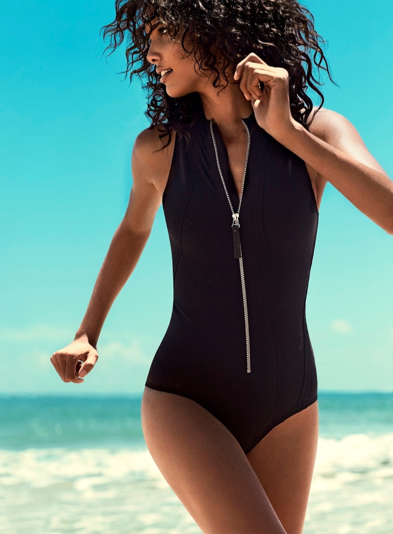 The French model poses in Acne Studios swimsuit with zipper detail