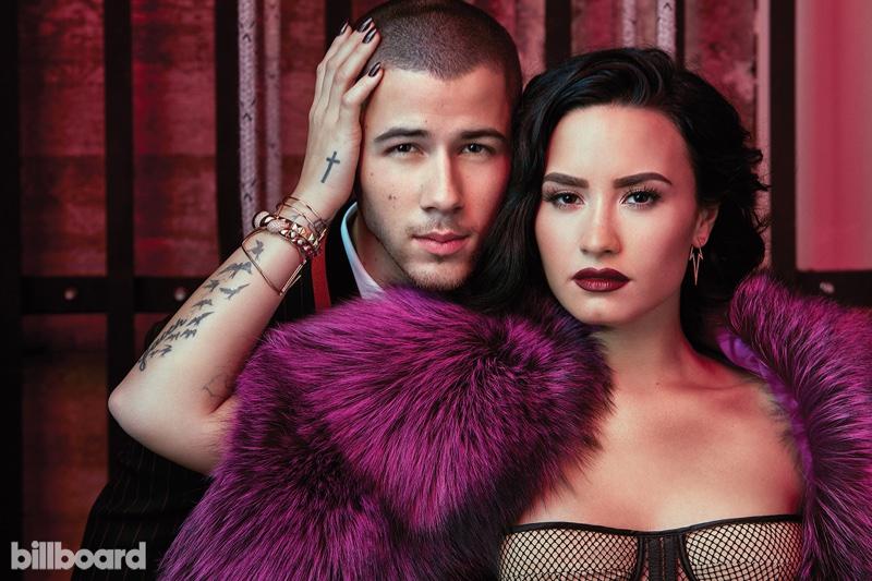 Demi Lovato poses in  fuchsia Adrienne Landau stole by Saulo Villela
