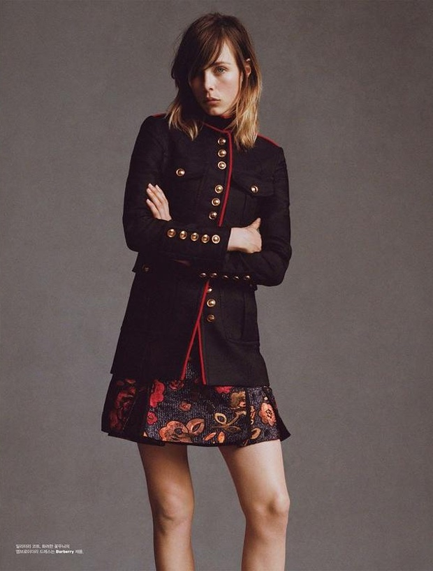 Edie Campbell models military inspired coat with floral embroidered skirt