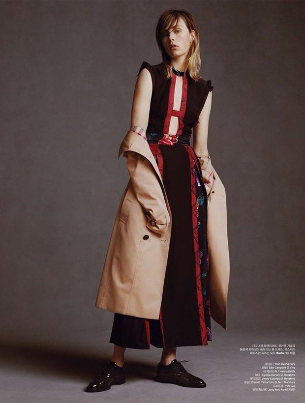 Edie Campbell models Burberry sleeveless dress with trench coat