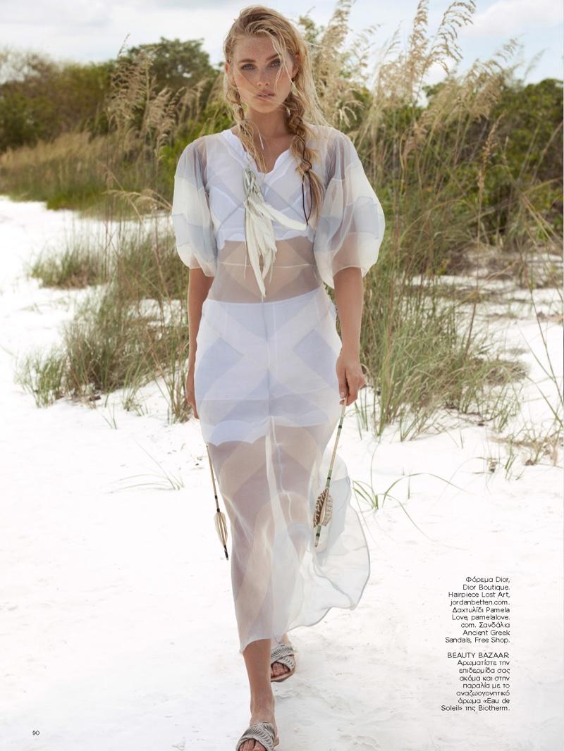 Elsa Hosk models sheer Dior dress with white crop top and shorts