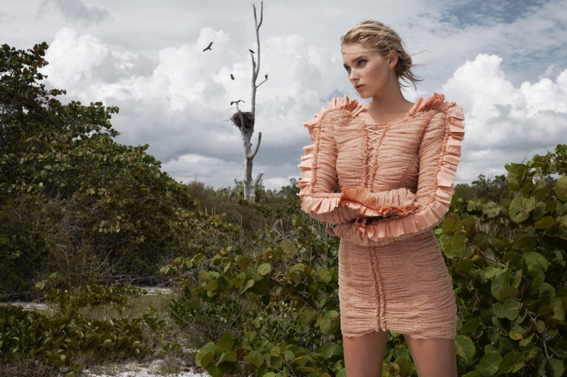 Elsa Hosk poses in bodycon Roberto Cavalli dress with ruffled sleeves