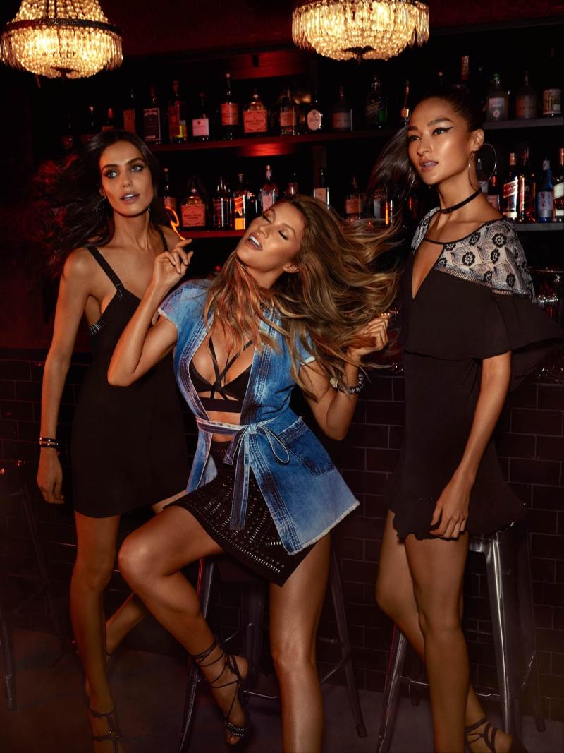 Gisele Bundchen, Amanda Wellsh and Bruna Tenorio pose at a bar for Colcci's spring 2017 campaign