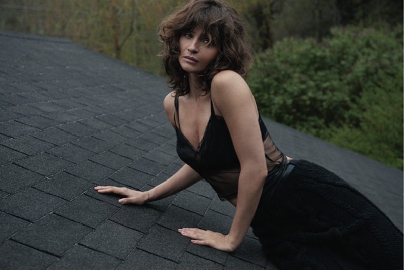 Helena Christensen wears black tank top and skirt