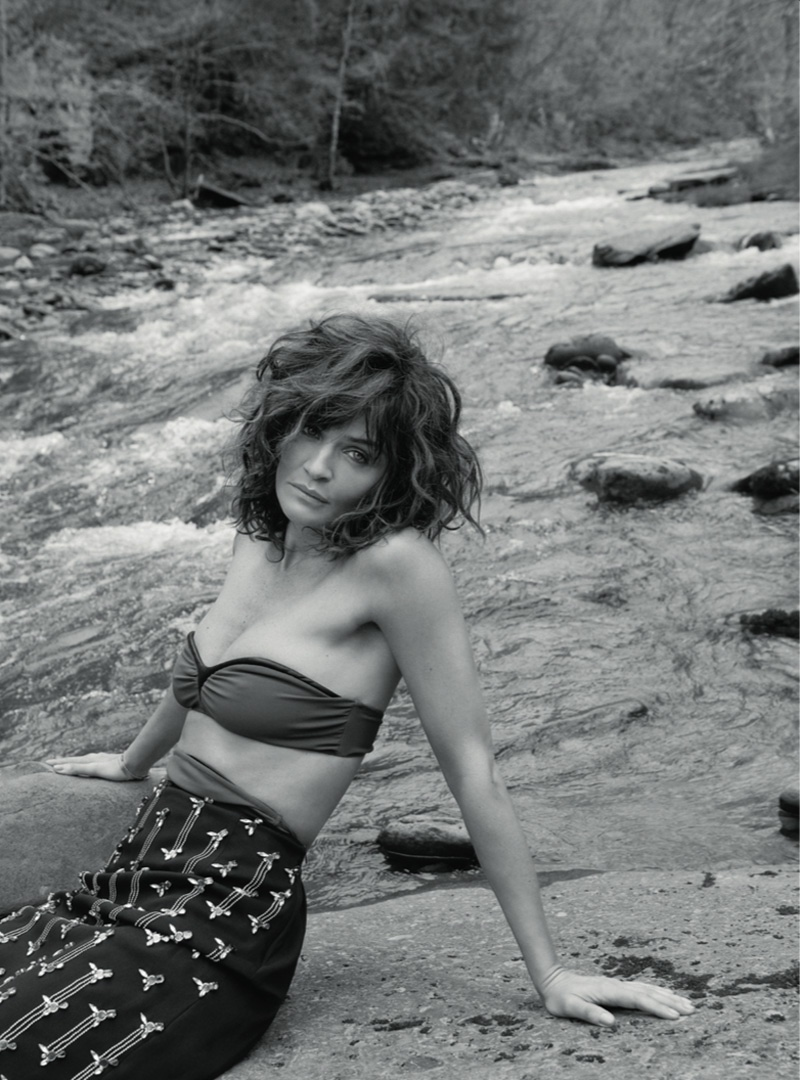 Helena Christensen wears bandeau top with embroidered skirt