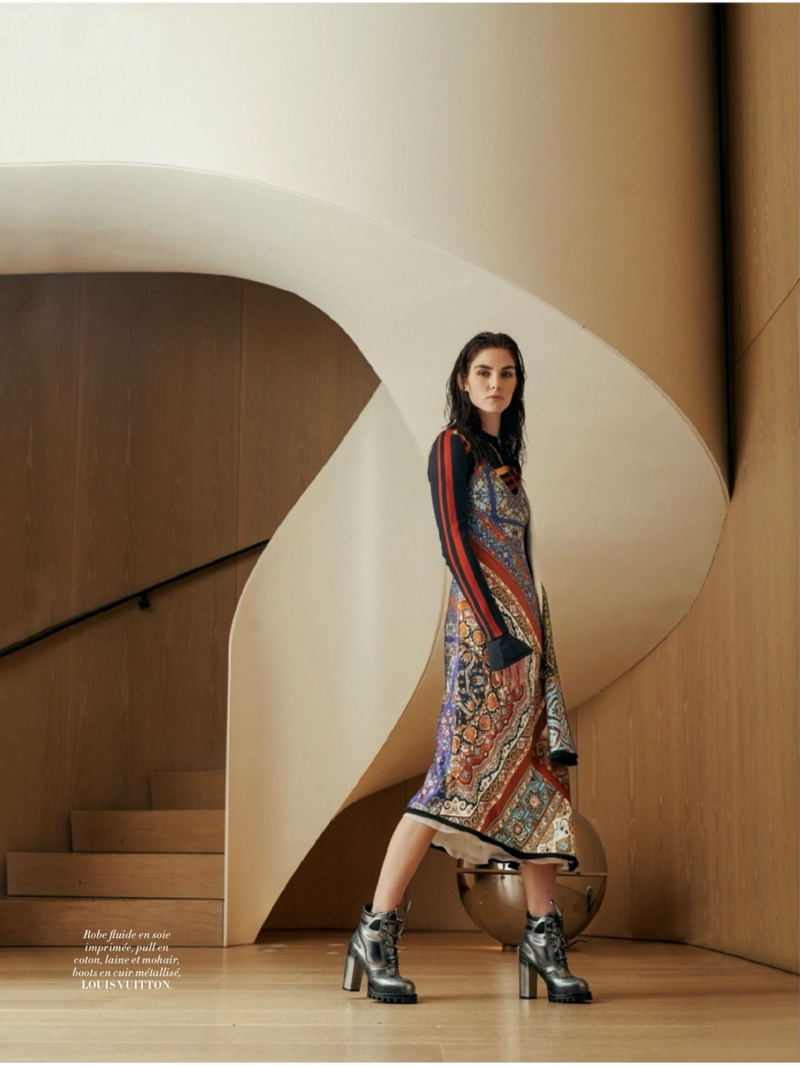 Hilary Rhoda wears Louis Vuitton sweater, embroidered dress and metallic boots