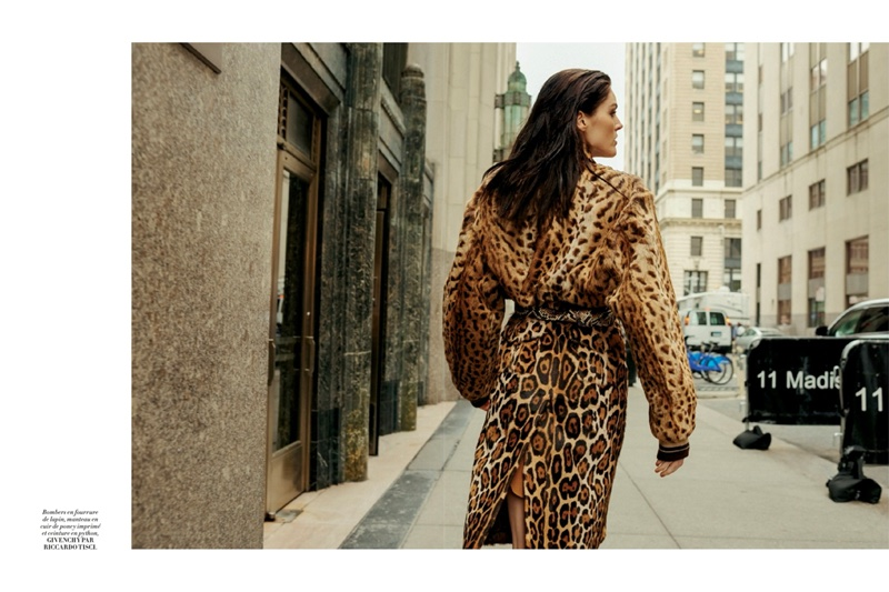 Walking the city streets, Hilary Rhoda wears cropped Givenchy fur coat and skirt