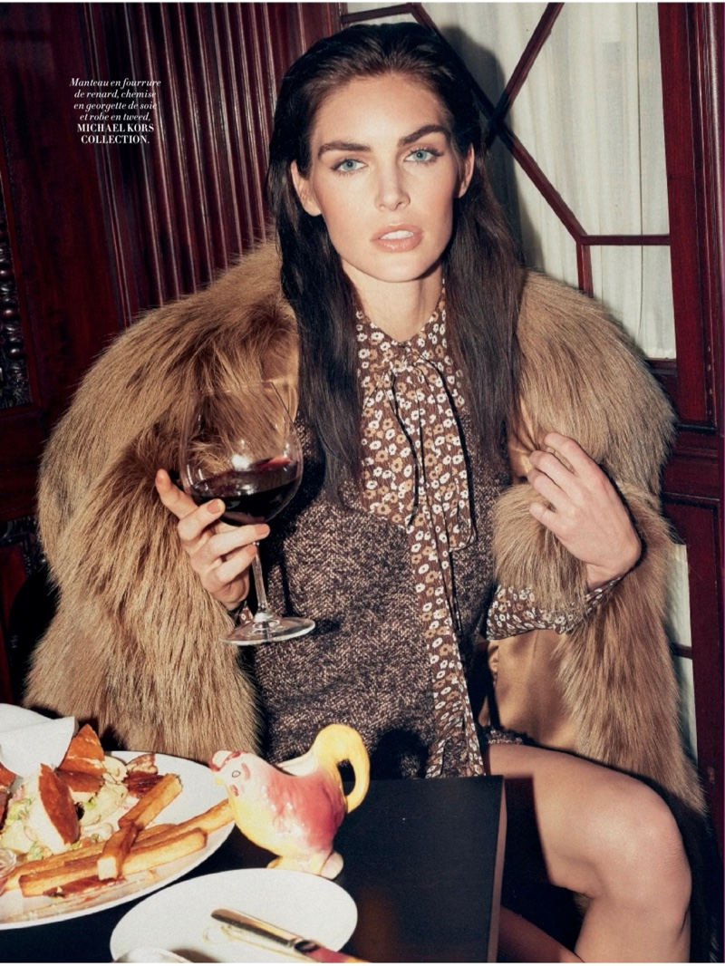 Hilary Rhoda enjoys a drink in Michael Kors Collection fur coat and tweed and silk dress