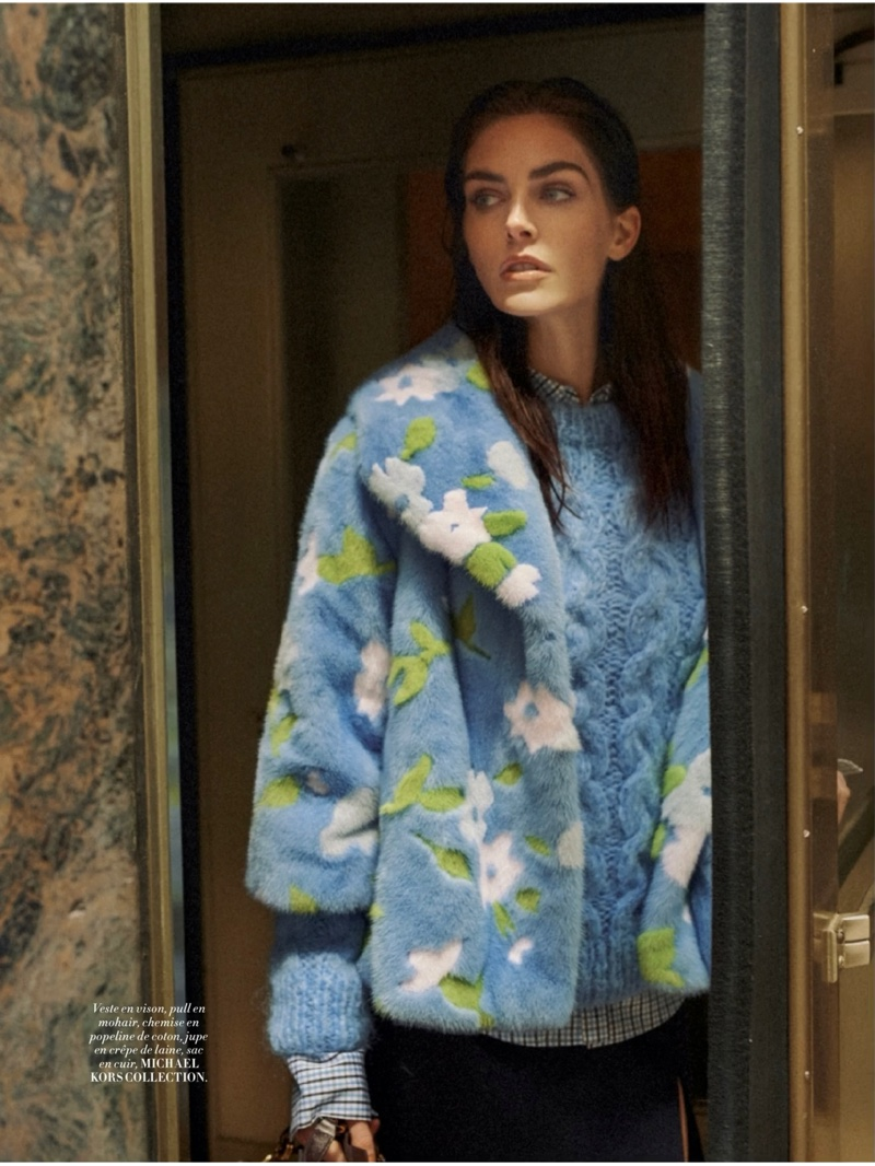 Hilary Rhoda stands out in a vibrant blue ensemble from Michael Kors Collection