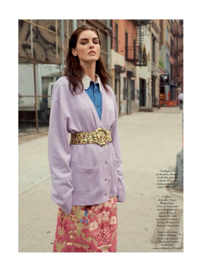 Hilary Rhoda wears pastel colored cardigan, denim shirt and skirt from Miu Miu