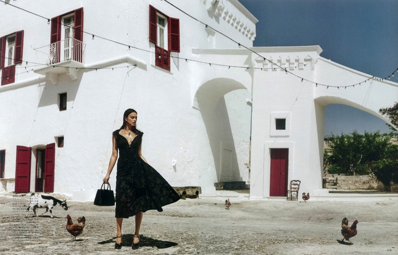 Irina Shayk models fit and flare dress from Miu Miu