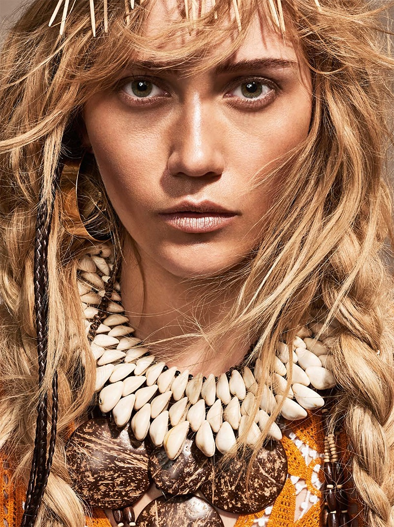 Photographed by Oliver Beckmann, the blonde model wears tribal chic fashions