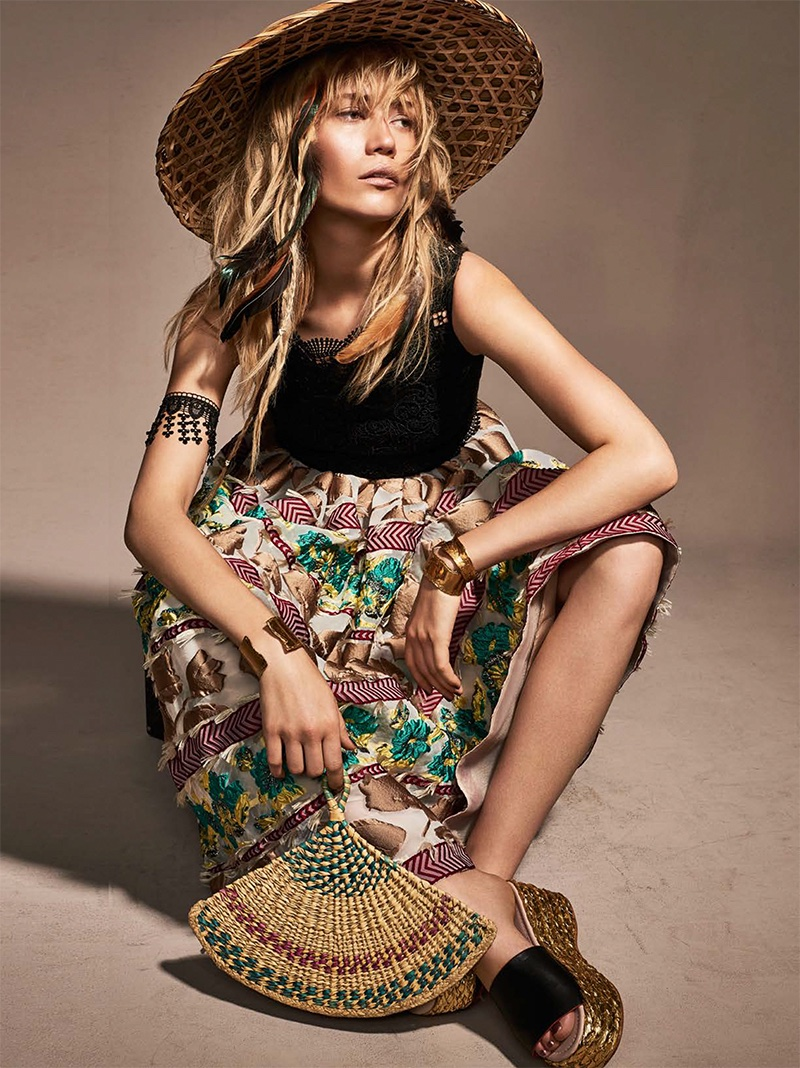 The blonde model wears embroidered top and jacquard skirt from Antonio Marras