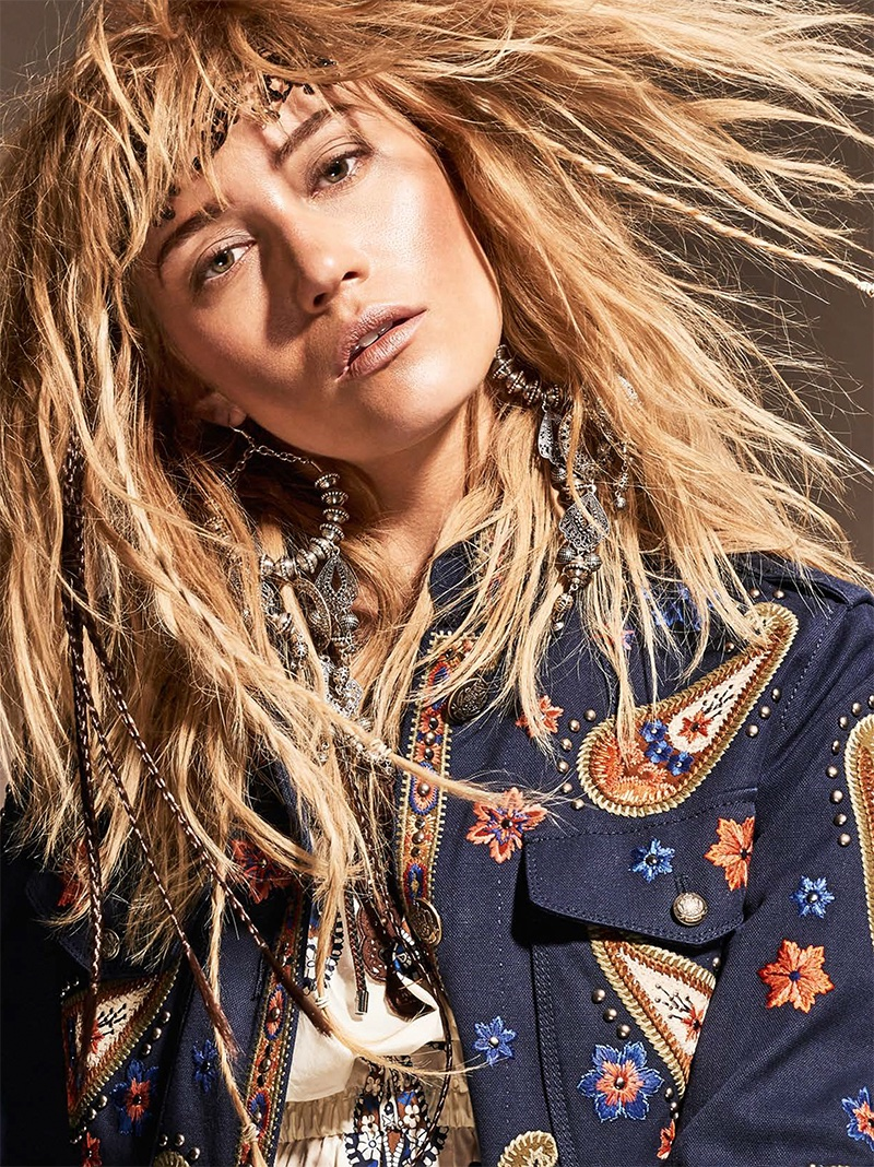 Josefin Bresan models wavy hairstyle with embroidered jacket from Fay