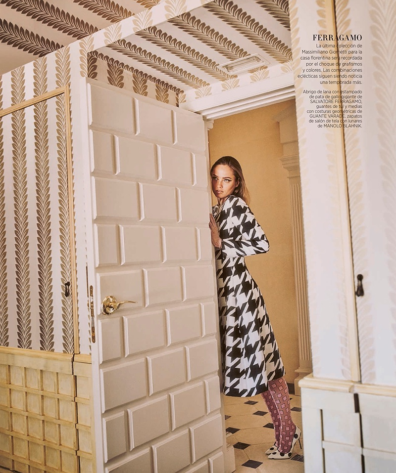 Karmen Pedaru poses in houndstooth print dress coat from Salvatore Ferragamo with Manolo Blahnik heels