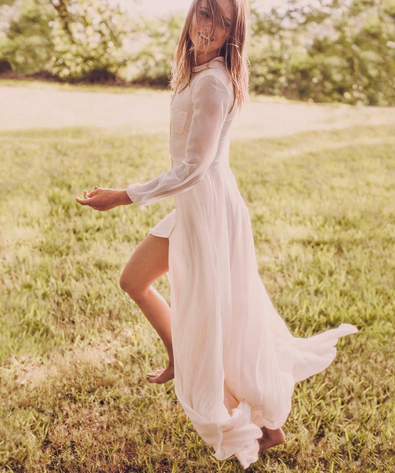 Karmen Pedaru is all smiles in breezy Carolina Herrera maxi dress