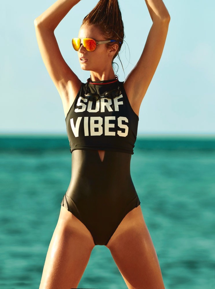 Kate Bock wears Billabong tank top with Mikoh swimsuit