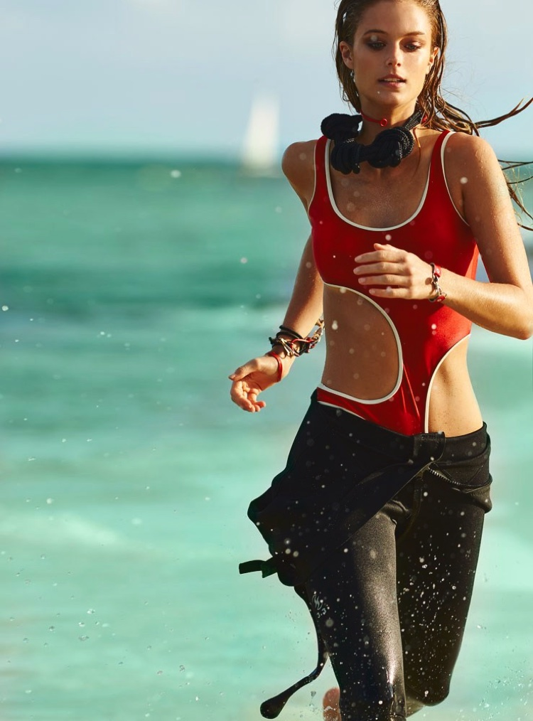Kate Bock serves a Baywatch moment, running in red monokini