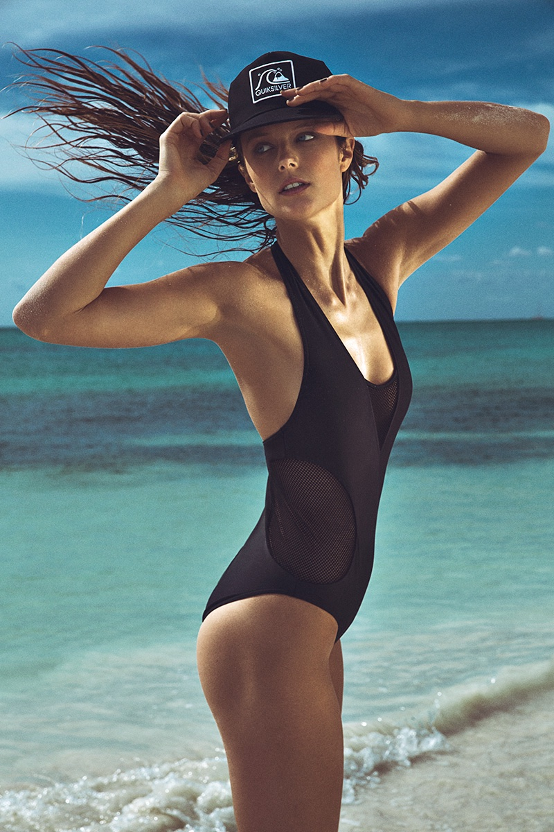Photographed by Richard Ramos, Kate Bock poses in black swimsuit styles