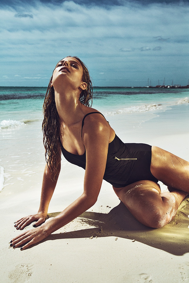 Soaking up the sun, Kate Bock wears a zip-adorned one-piece swimsuit