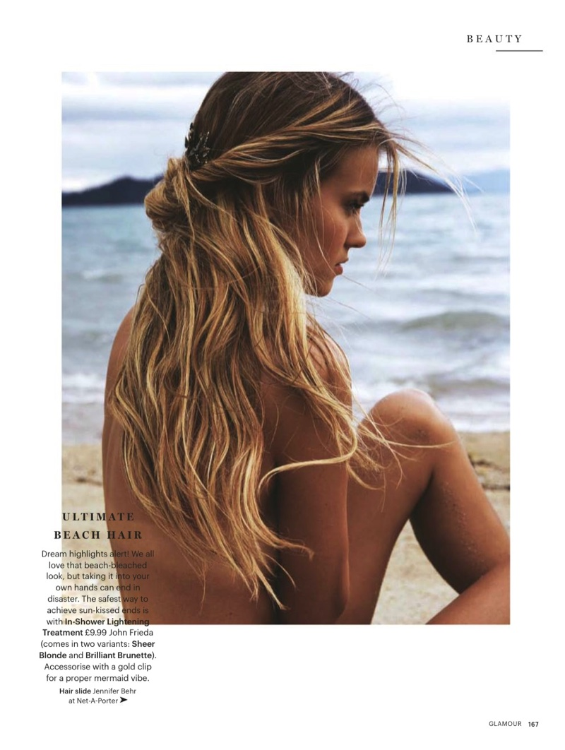 The blonde model wears beachy waves in the feature