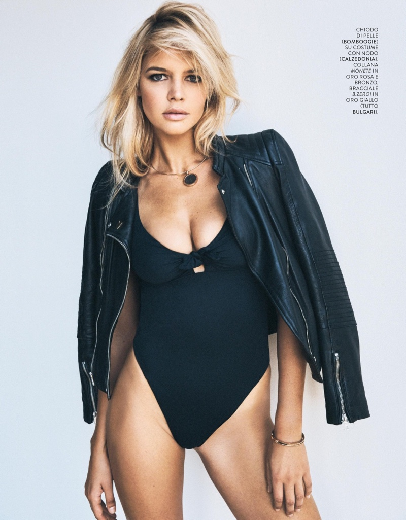 Kelly Rohrbach wears black jacket and bodysuit
