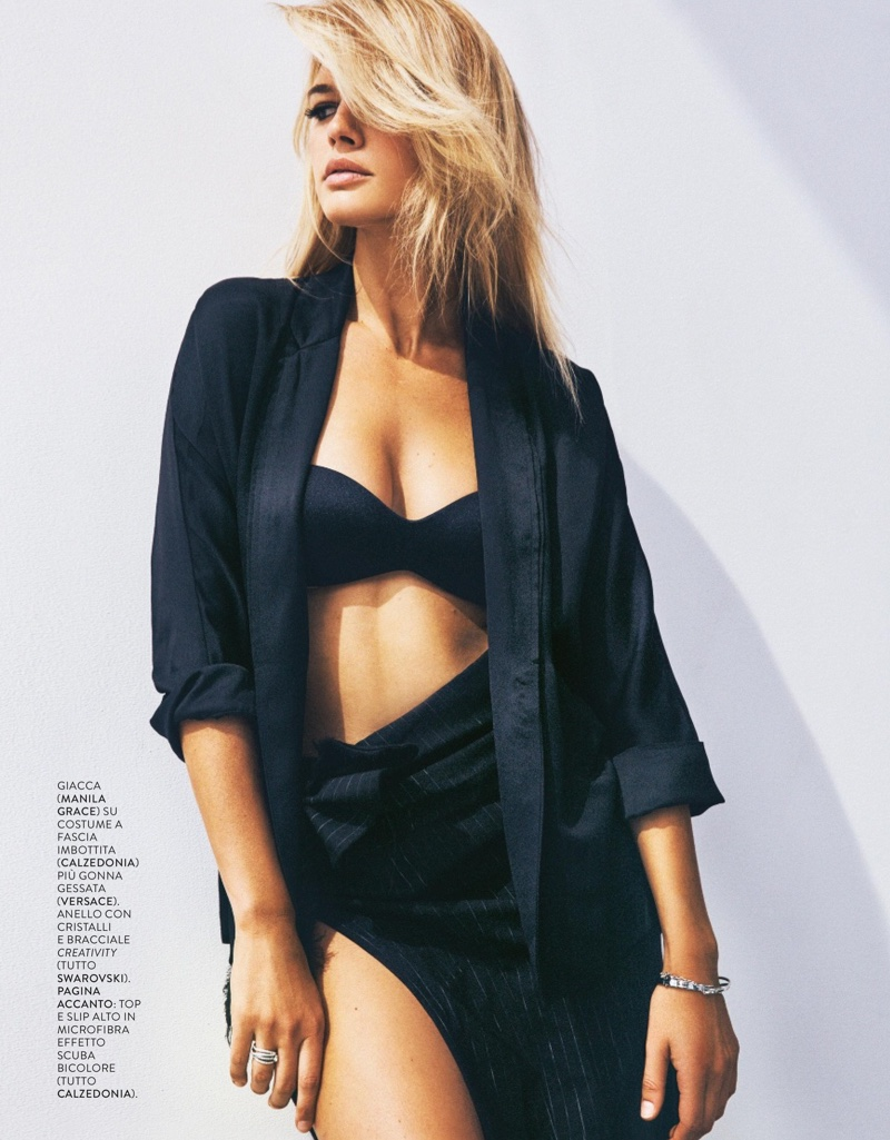 Kelly Rohrbach flaunts some skin in black blazer, bra and mini skirt