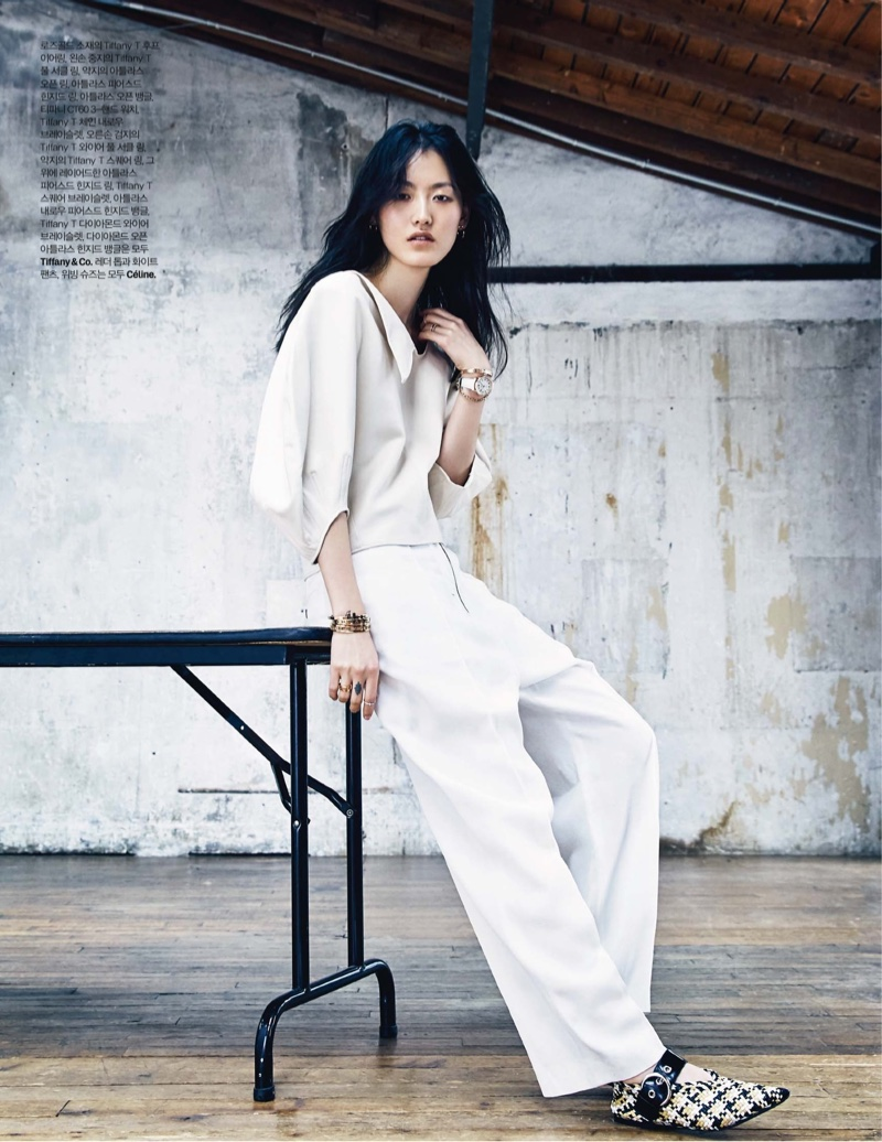 Hye Sung Lee models Celine top, trousers and shoes with Tiffany & Co. jewelry