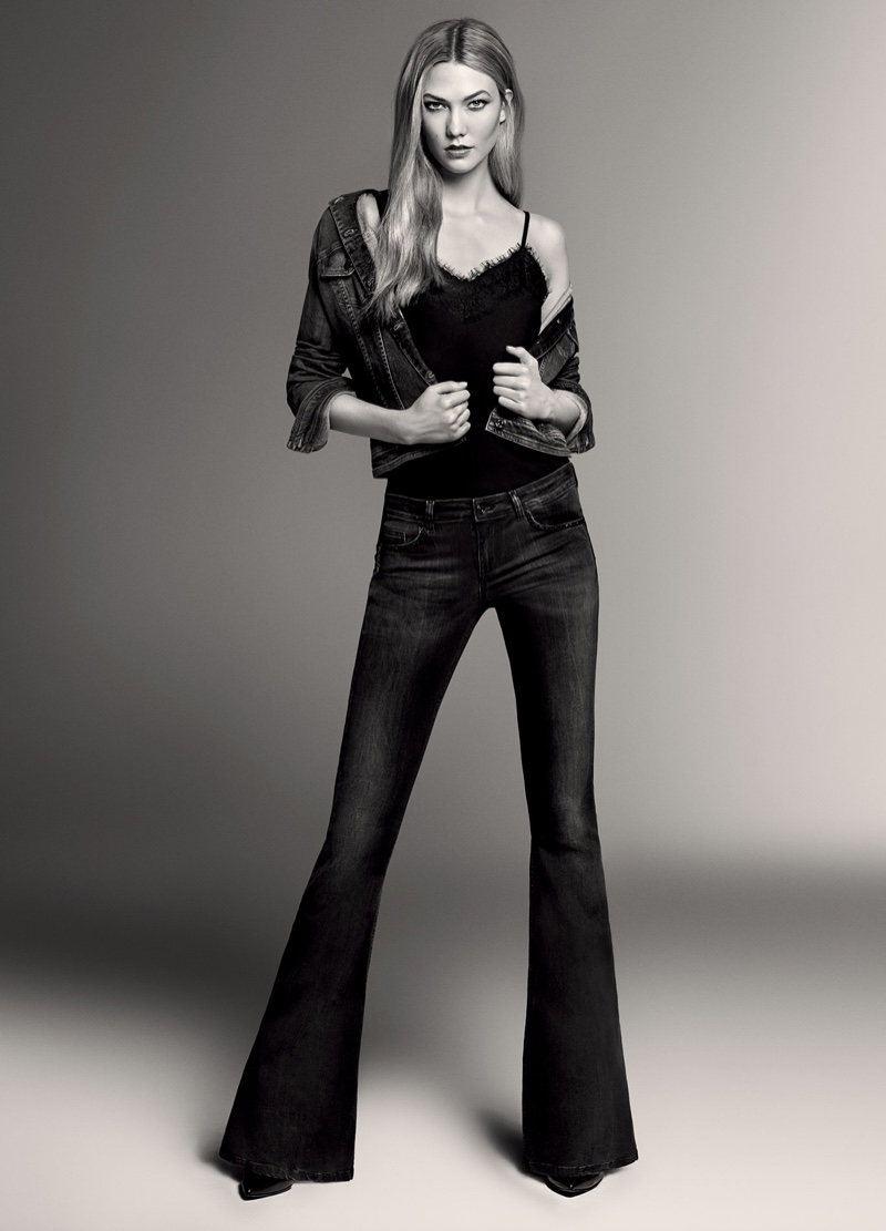 Karlie Kloss poses in camisole top, denim jacket and flared jeans from Liu Jo