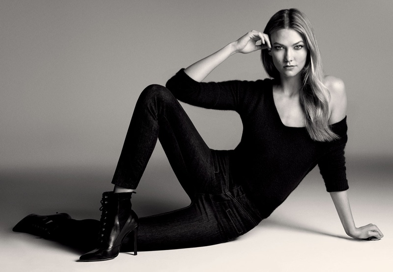 Karlie Kloss poses for Liu Jo, modeling sweater and slim fit denim with ankle boots