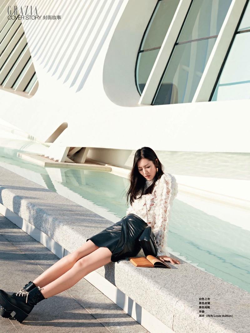 Liu Wen models Louis Vuitton top, skirt and boots