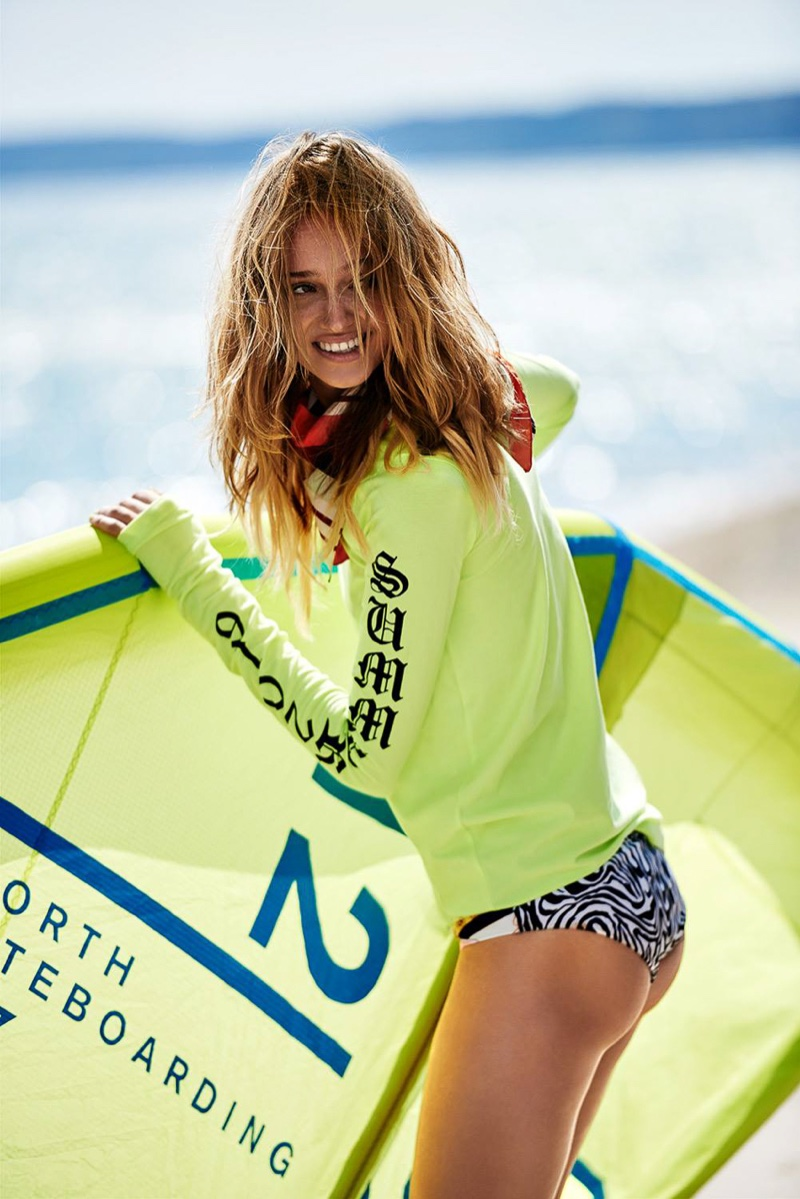 Surf's up as Michalina Glen wears long-sleeve shirt with printed bikini bottoms