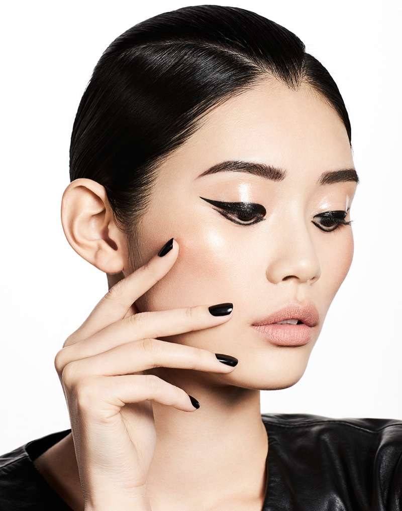 Ming Xi wears graphic eyeliner with a black manicure